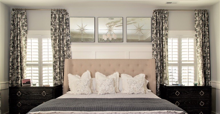 High-end bedroom with plantation shutters.