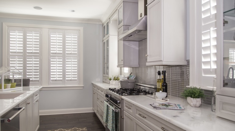 Plantation shutters in Gainesville kitchen with marble counter.