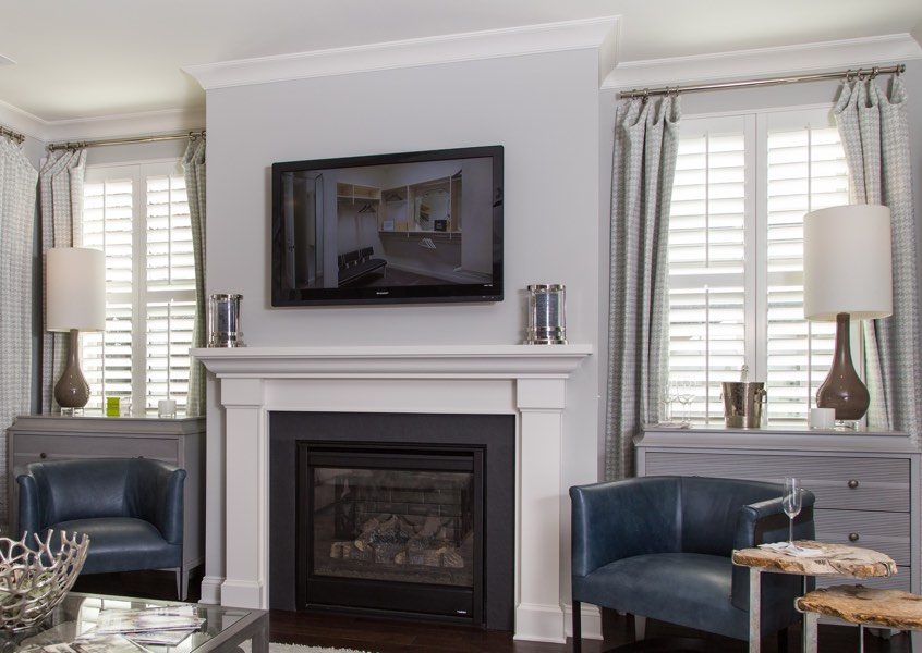 tv room Gainesville faux wood shutters