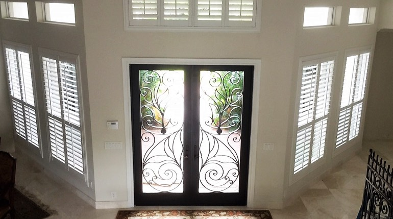 Gainesville foyer with glass doors and interior shutters