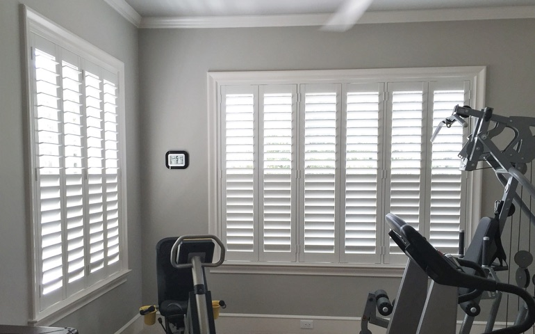 Gainesville exercise room with shuttered windows.