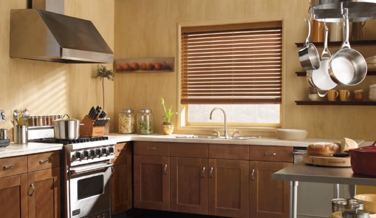 Gainesville kitchen faux wood blinds.