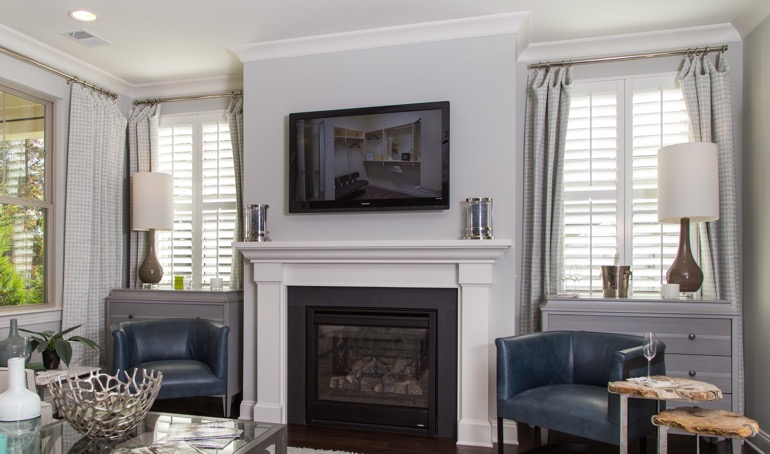 Gainesville fireplace with white shutters.