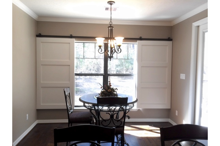Gainesville dining room with sliding barn door shutters.