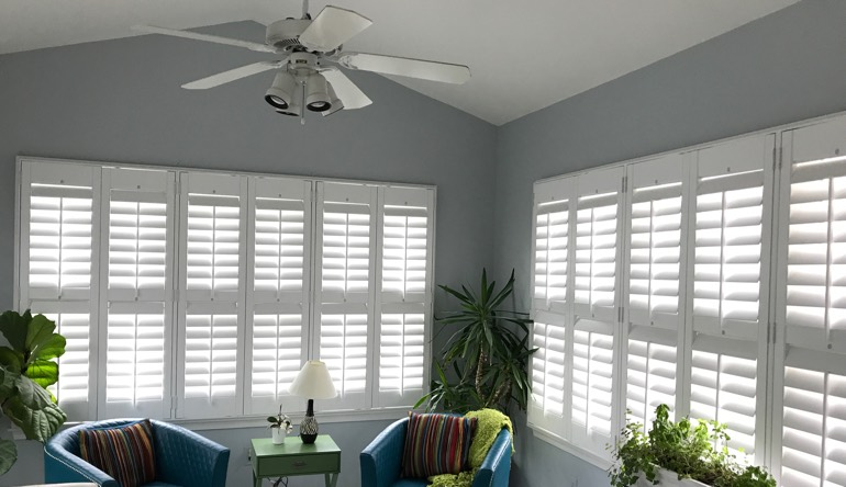 Gainesville sunroom with fan and shutters