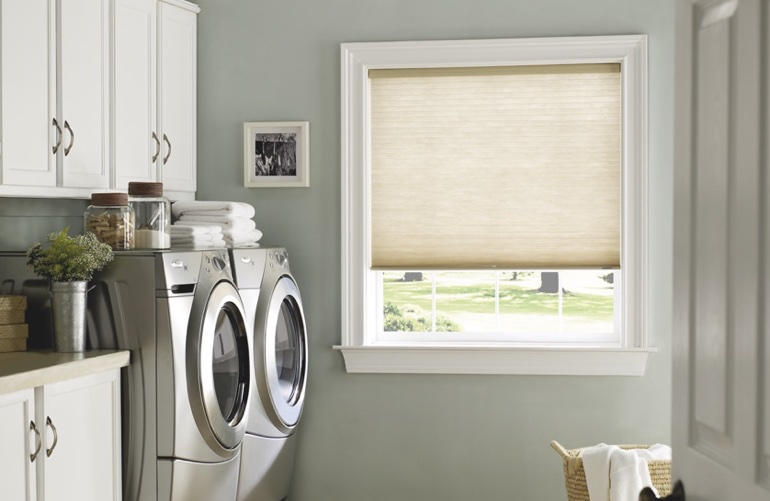 Gainesville laundry room with tan window shades.