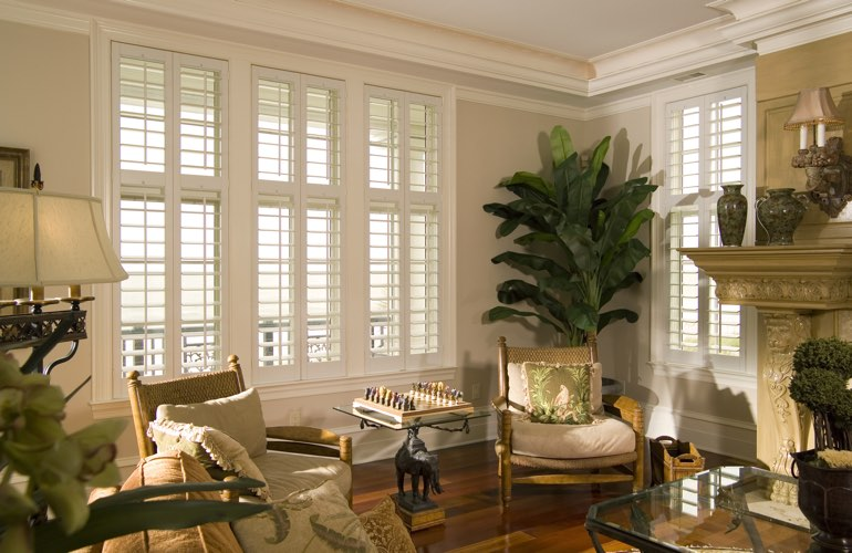 Living Room in Gainesville with white plantation shutters.