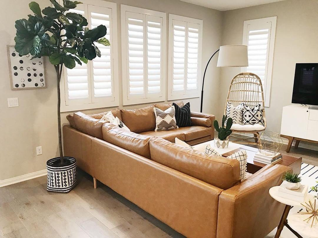 Warm living room with our Polywood shutters in Gainesville.