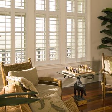 Gainesville living room plantation shutters.