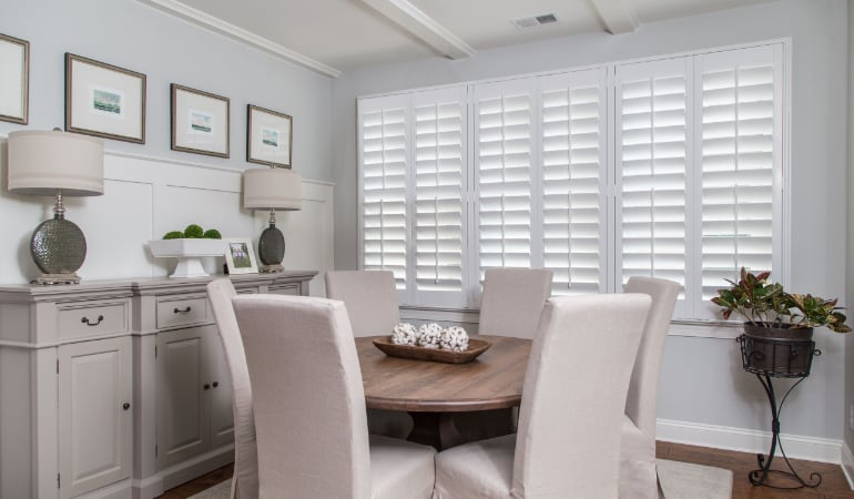 Plantation shutters in a Gainesville dining room.