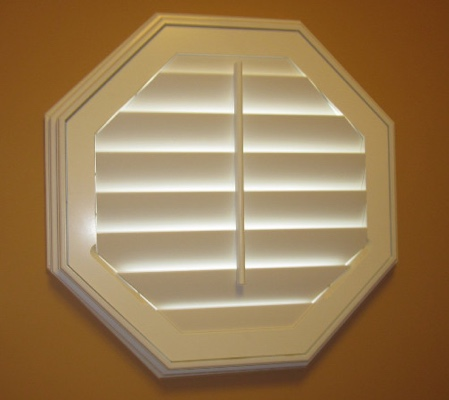 Gainesville octagon window with white shutter
