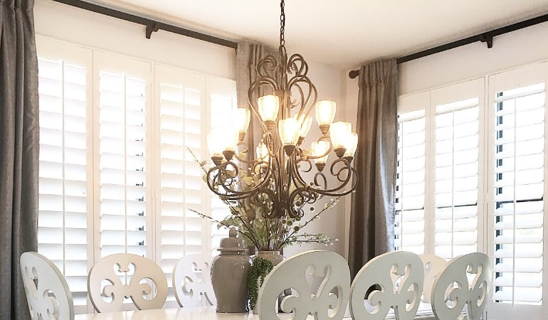 Plantation shades in a dining room.