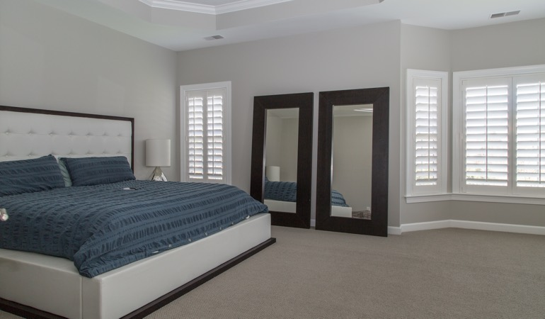 Polywood shutters in a minimalist bedroom in Gainesville.
