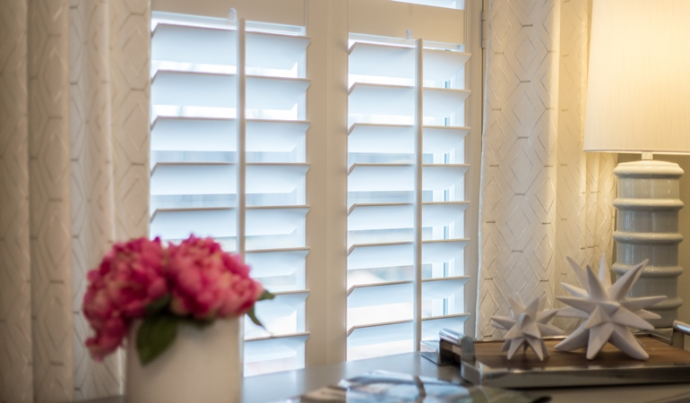 Plantation shutters by flowers in Gainesville
