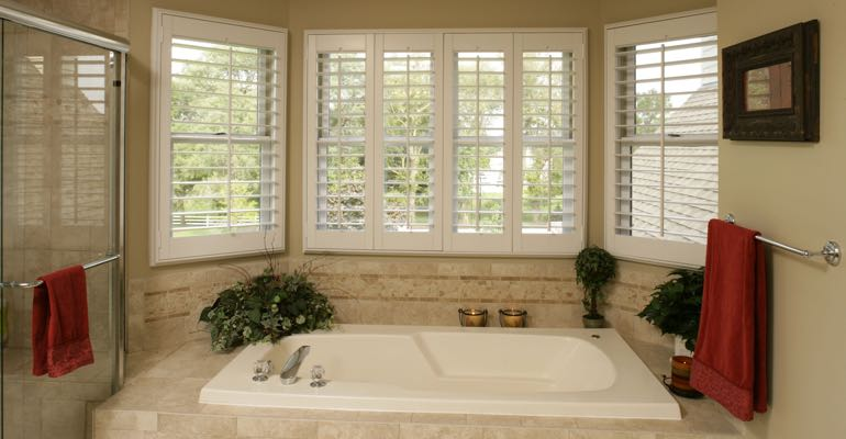 Plantation shutters in Gainesville bathroom.
