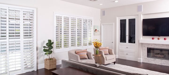 Gainesville living room in white with plantation shutters.