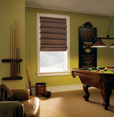 Roman shades in Gainesville game room with green walls.