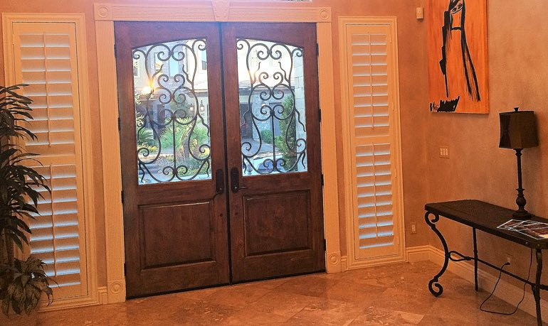 Gainesville foyer door with shutters