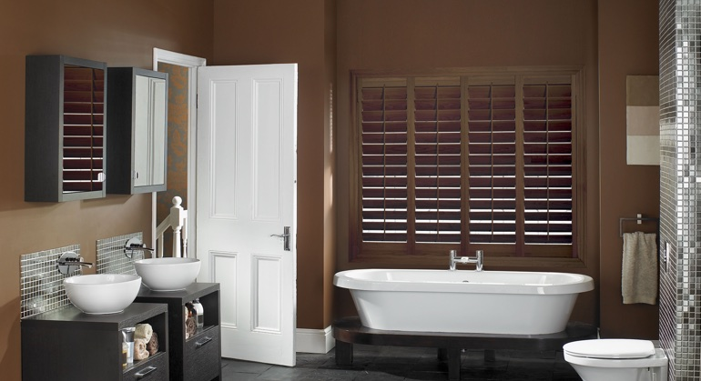 Stained wood shutter in Gainesville bathroom