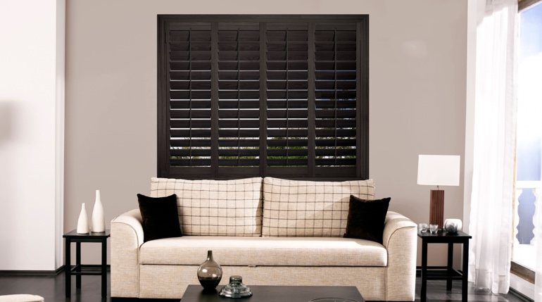 Gainesville sunroom with plantation shutters.