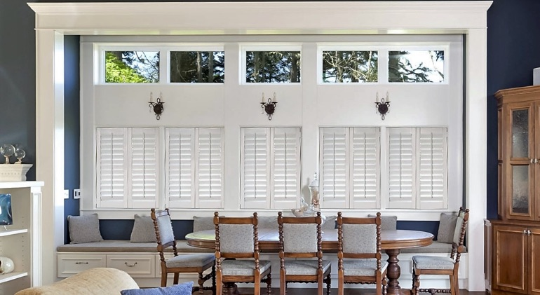 Shut white plantation shutters in Gainesville great room.