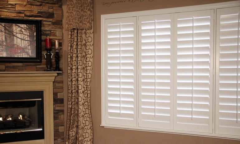 Gainesville Studio plantation shutters in family room.