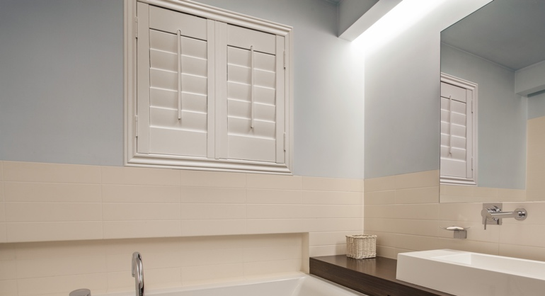 Plantation waterproof shutters in Gainesville bathroom.