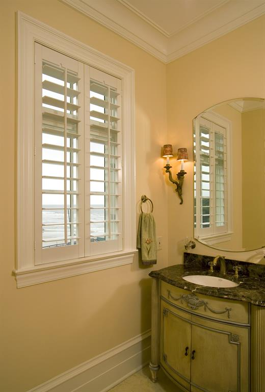 Plantation shutters in a bathroom outlooking the ocean