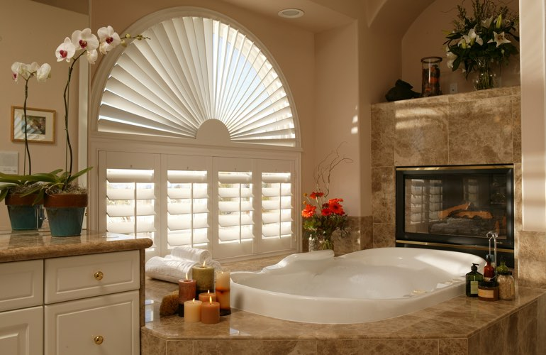 Semicircle shutters in a Gainesville bathroom.