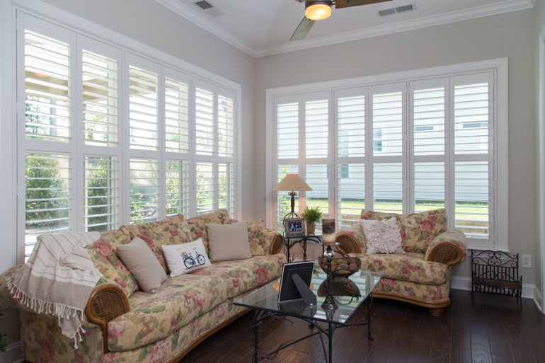 Traditional sunroom with plantation shutters in Gainesville.