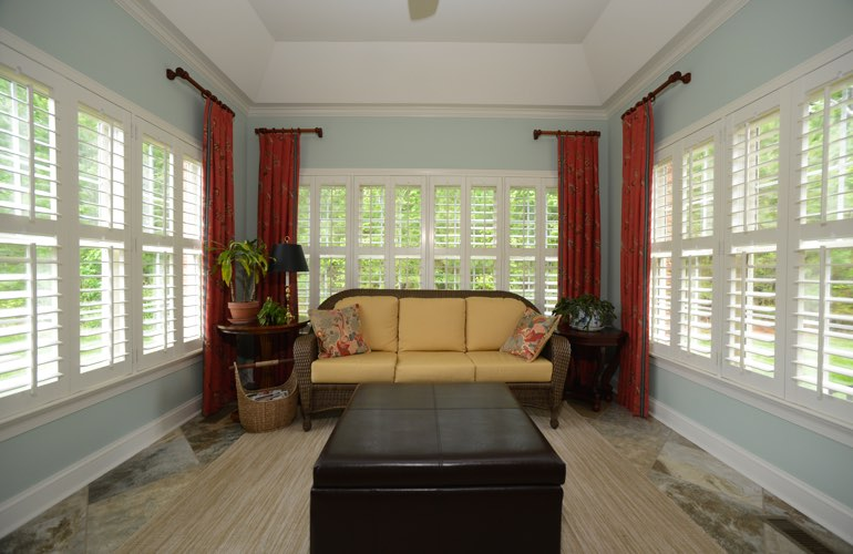Gainesville sunroom with beautiful window shutters.