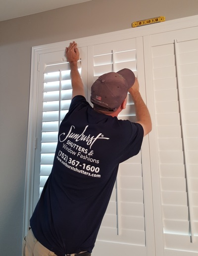 Shutter installation in Gainesville bedroom.