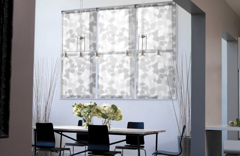 Light gray patterned shades in light blue dining room