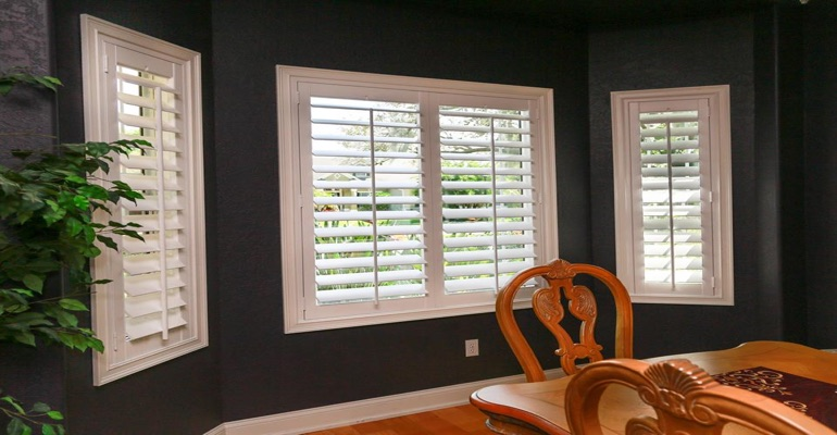 Crisp Polywood Plantation Shutters In Dining Room With Dark Paint
