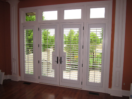 Gainesville patio door with sidelight shutters