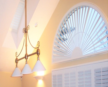 Gainesville arched eyebrow window with custom shutter