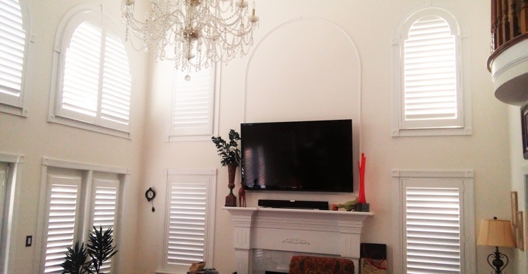 high ceiling windows with shutters Gainesville living room