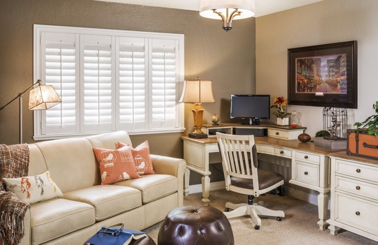 Gainesville home office with white window shutters.