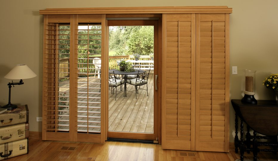 Bypass wood patio door shutters in Gainesville living room