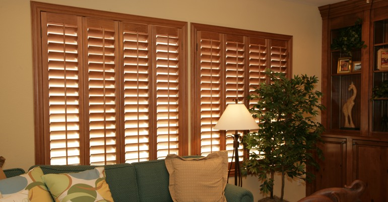 Natural wood shutters in Gainesville living room.