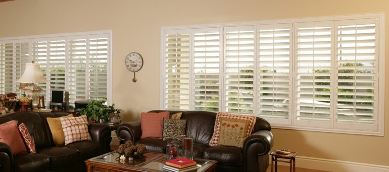 Wide window with interior shutters in Gainesville living room